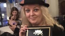 Michelle Dooley Mahon with her award