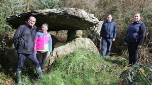 Deputy Paul Kehoe, Sinead Kehoe, Cllr Cathal Byrne and Betty Kelly, chairperson of Bree Walking Trails, at the Ballybrittas Portal Tomb near Bree village