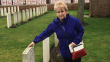 Margaret touching the headstone at her grandfather's grave. It was the first time that any member of the family had seen or visited his final resting place
