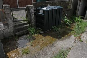 Water running constantly at the back of Ger Roberts House 4 Antelope Road.