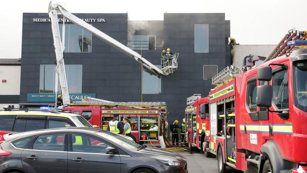 Firefighters work to bring the blaze at McCauley's under control on Sunday afternoon