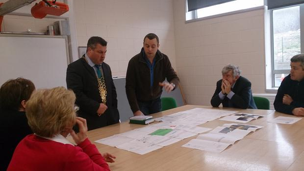 Mayor Cllr. George Lawlor looks over plans of the new school pitch at Barntown National School with local man and school adviser Michael Brazzill and Board members Philomena Roche, Claire Byrne, Councillor Tony Dempsey and Mark Brazzill.