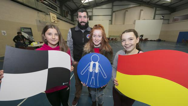 Educate Together's Eliza Kelly, Ella Browne and Fleur Lambert with Oisin Foden of Irish Water Safety