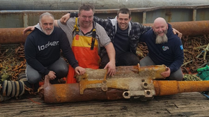 The crew of Wexford trawler The Saltees Quest with the anti-aircraft gun they discovered off the south east coast