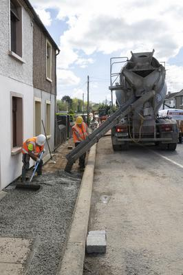 Concrete is laid on the footpath at Maudlintown