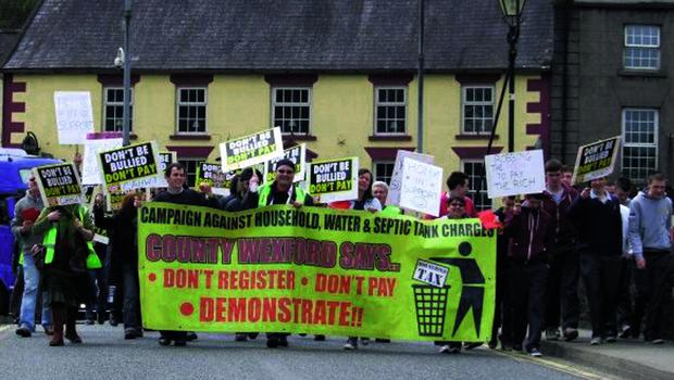 Protestors crossing the old bridge in Enniscorthy, thereby preventing ordinary traffic from doing likewise.