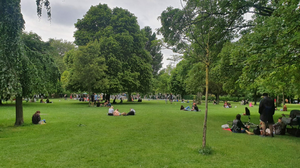 People enjoying a sunny St Stephen's Green in a quieter than usual Dublin on Sunday