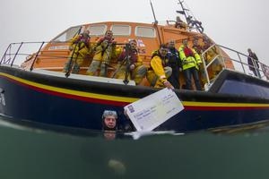 The handing-over of the cheque from Wexford Sub Aqua Club to the Kilmore Quay branch of the RNLI (from left): Tony Parle, Trevor Devereux, Niall McGee, Michael Rossiter, Derek McDonnell (in water), Johnny Moore, Nick Kendall, Sam Nunn, Alan Hinchy, and Eugene Kehoe