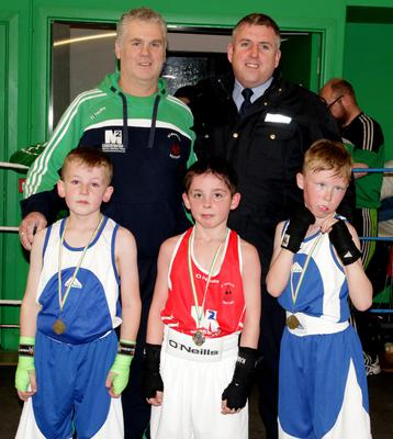 James Cullen, CBS Boxing Club, Ruairi O'Connor, St Ibar's, and Shane Turner, Enniscorthy Boxing Club, with Donal Walsh, referee, and Garda Niall Murphy