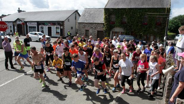 AND THEY'RE OFF! The run gets under way,  started by Pat Durack of Maxol Ardcavan the event's main sponsor.