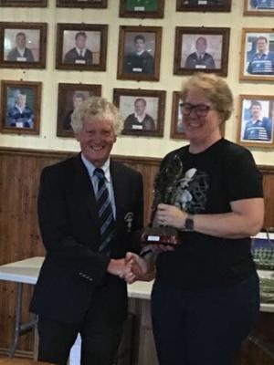 Wexford Wanderers RFC Club Person of the Year award winner Bettie Marie Smit receives her award from club President Brian McGonigal
