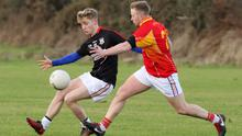 Conor O'Reilly of Forth and Bargy Gaels battles with Declan Courtney of the Starlights