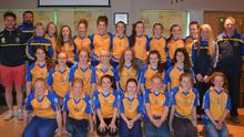 The Taghmon-Camross Féile girls' squad with Ben Brosnan and mentors at their presentation of jerseys sponsored by James Lacey Engineering Ltd. Thanks to Ben Brosnan (Bodibro), Fr. David Murphy, George Dee (Taghmon-Camross L.G.F.A.) and all parents and friends for making this a special night for the girls. The gear will be worn with pride for Féile 2015 this weekend.