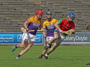 Paul Murphy of Faythe Harriers keeps an eye on Ben Edwards of Rapparees in Wexford Park