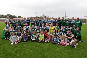 The St.John's Volunteers squad and mentors with young supporters after Saturday's success
