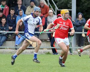 Brian O'Loughlin of Monageer-Boolavogue is pursued by Craanford's William Conroy in The Courtyard Ferns IHC quarter-final