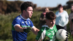 Cian Kinlough (Crosssabeg-Ballymurn) evading David Roche (Glynn-Barntown) in last September's Wexford District Junior 'B' football championship final, held in Carne and won by the latter (2-14 to 3-9)