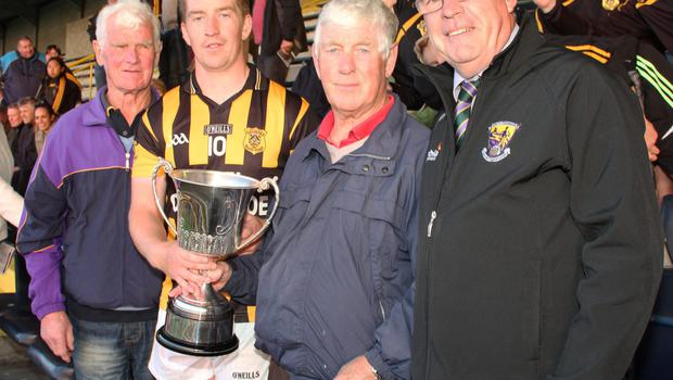 Joe Kelly, Shelmaliers captain, with Kevin and Dick Murphy after receiving the Pat Murphy Memorial Cup from Diarmuid Devereux, Co.Chairman