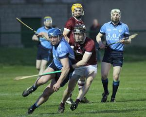 Tomas Cullen of St. Anne's survives this strong challenge from Joe O'Connor (St. Martins)