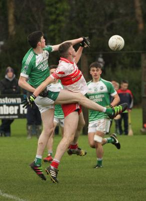 Niall Hughes battling in the air with Seán Lyster of St. Mary's