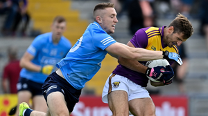 Wexford's Brian Malone is tackled by Dublin attacker Paddy Small. Photo: Brendan Moran/Sportsfile