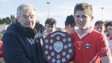 Pat Henderson presenting the shield to Andrew Walsh