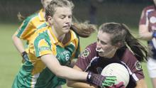 Rachel Murphy of HWH-Bunclody is tackled by Lorna Fortune (Clonee)