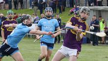 Wexford's Conor Foley avoids this attempt at a hook by Ryan Malone of Dublin