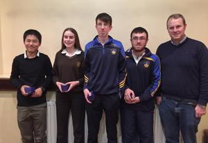 The winning St. Mary's (Rosslare) quiz team of Andy Lin, Claire McDonnall, David McDonnell and Manus Harte with quizmaster Joe Cummins