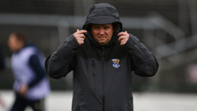 Davy Fitzgerald protecting himself from the elements on the day of his side's Allianz Hurling League quarter-final loss to Galway