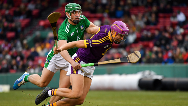 Jack O'Connor tries to escape the close attention of Limerick's Seán Finn in Boston on Sunday