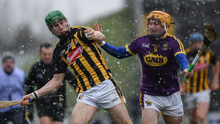 Wexford's outstanding sweeper, Kevin Foley, putting pressure on Martin Keoghan of Kilkenny