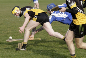 Ballygarrett midfielder Cormac Moore feels the heat from Danny Nolan of Eire Og.
