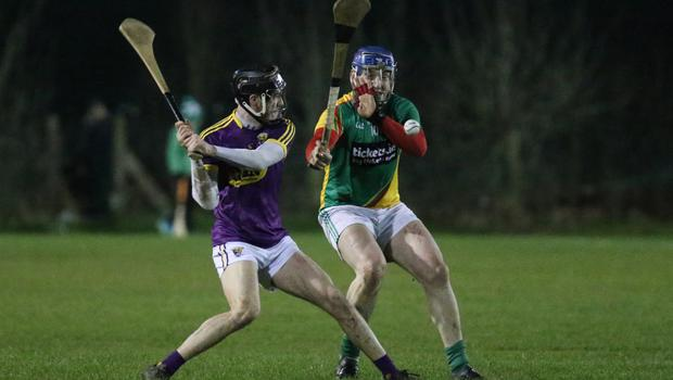 Wexford midfielder Joe O'Connor about to strike the ball as Carlow's Seamus Murphy moves in. Murphy was sent-off for an incident in the immediate aftermath