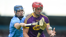 Wexford joint captain Lee Chin taking on Dublin defender Eoghan O'Donnell