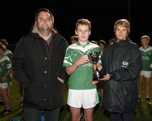 Jayden Cheevers, the St. James' captain, with Dean Goodison representing People Newspapers (sponsors) and Angela McCormack of Coiste na nOg Loch Garman.