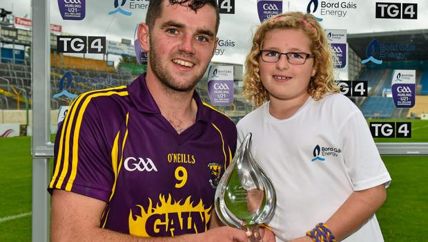 Tony French is presented with his Man of the Match award by eight-year-old Kirsty Cheevers from Ballyhack