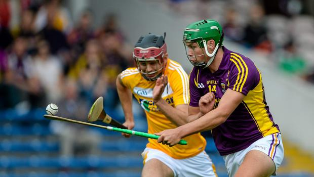 Conor McDonald is pursued by Antrim's Maol Connolly during the first-half of Saturday's encounter
