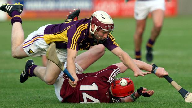 James Breen goes to ground with Conor Whelan of Galway