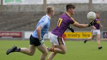Mikie Dwyer on the move for Wexford as Dublin's Eoin O'Dea tries to close off his run