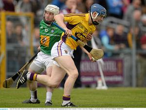 Rory Jacob bursts away from Alan Devine of Westmeath