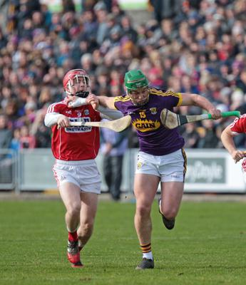 Wexford's Conor McDonald holds off Daniel Kearney of Cork