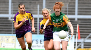 Aisling Halligan and Sarah Harding-Kenny trying to curb Kerry scoring ace Louise Ní Mhuircheartaigh. Photo by Michelle Cooper Galvin