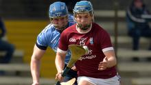 Mikey Coleman of St. Martin's moving away from Tomás Cullen (St. Anne's) towards goal