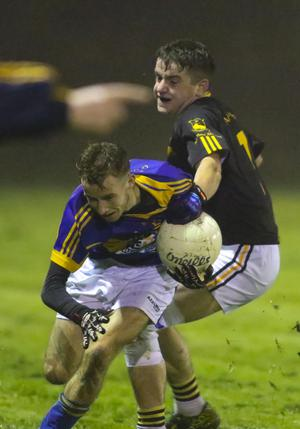 Jake Byrne of Geraldine O'Hanrahans is tackled by Tomás French