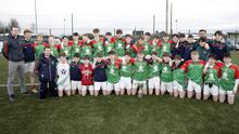 The triumphant Gorey Community School with their mentors after the impressive Leinster final triumph on the Bray Emmets astro turf on Monday of last week