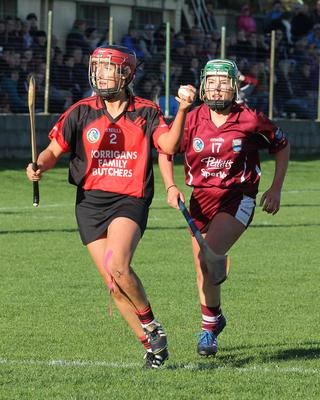Aoife O'Connor (Oulart-The Ballagh) is chased by Lisa Firman