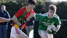 Conor Roche of Kilross Gaels is tackled by Dylan Whelan