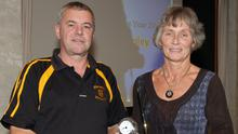 Michael Foley of Rathnure receives his clubperson of the year award from Marguerite Furlong (Vice-Chairperson) at the Coiste na nOg Convention