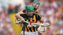 Kilkenny's Paul Murphy is wrapped up by Wexford substitute Harry Kehoe. Photo by Daire Brennan/Sportsfile